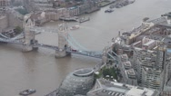 Aerial view of Tower Bridge and eastern side of river Thames, London Stock Footage