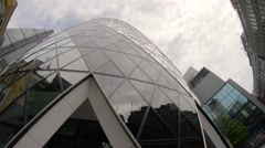 LONDON –Street view of Gherkin building (30 St Mary Axe) at Stock Footage