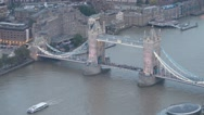 Aerial view of traffic on Tower Bridge over Thames river, London Stock Footage