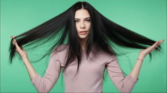 Woman playing with long beautiful hair Stock Footage