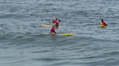 A group of lifeguards and their paddleboards. Stock Footage