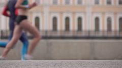 Defocused city marathon runners. Legs closeup. Competition concept. 4K long shot Stock Footage