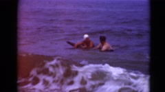 1947: couple is having fun in the ocean MIDDLETOWN Stock Footage