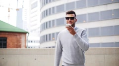 Man using voice command recorder on smartphone Stock Footage