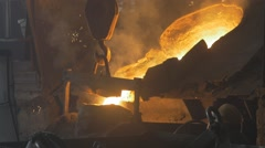 Transfusion of red-hot steel in a steel mill Stock Footage