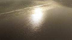 Sun reflecting from water surface near edge of melting ice cover Stock Footage