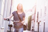 City Lifestyle - Woman with Bicycle Stock Photos