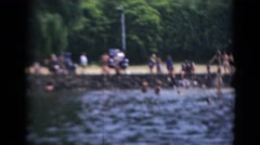 1947: people diving and cooling off while enjoying swimming near lake MIDDLETOWN Stock Footage
