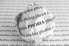 Crumpled paper ball with words Phobia Stock Photos