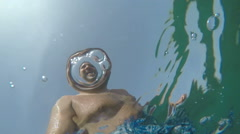 Underwater slowmotion view of a man through water surface Stock Footage