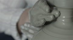 Hands working on pottery wheel, shaping a clay pot Stock Footage
