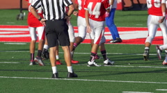 A referee and men playing American football. Stock Footage