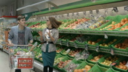 A young couple goes shopping Stock Footage