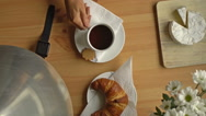 Woman's hand takes a Cup of coffee and a smart watch. Top view. Zoom out. Stock Footage