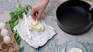 Spreading butter on baking pan Stock Footage