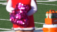 Detail of high school cheerleaders cheering with their pom-poms at a football ga Stock Footage
