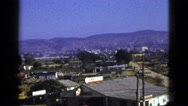 1953: quaint town near the base of mountain range on clear and sunny day. BOSTON Stock Footage