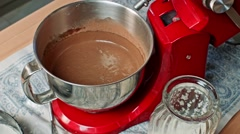 Pouring chocolate dough into baking pan Stock Footage