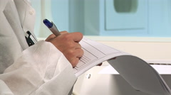 Woman in protective suit taking notes Stock Footage