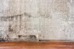 Repairing room old concrete wall and dirty brown floor Stock Photos