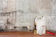 Repairing room old concrete wall, dirty brown floor and tools Stock Photos
