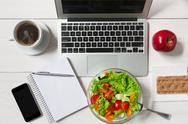 Healthy business lunch snack in office, vegetable salad top view Stock Photos