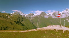 Flag of Austria on the top of Grossglockner road Stock Footage