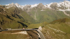 Austrian flag on the top of Grossglockner mountain pass in the Alps Stock Footage
