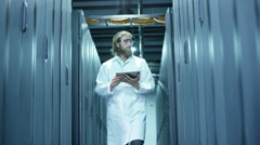 Technician Working and Walking In a Server Hallway. Stock Footage