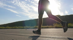 Young strong man running on countryside path. Male runner jogging Stock Footage