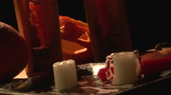 Vampire table with bloody teeth, candles and scary Jack O' Lantern pumpkin Stock Footage