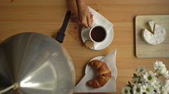 Woman's hand takes a Cup of coffee and a smart watch. Top view. Stock Footage
