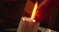 Soft focus melting red wax on white candle Stock Footage