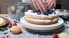 Girl is putting blueberry on shortcake Stock Footage
