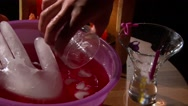 Pour punch drink on Halloween party, ice hand in punch drink Stock Footage