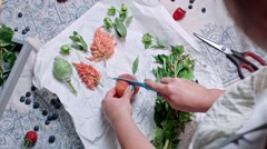 Cutting peach in two with knife. Fresh green decoration for food Stock Footage