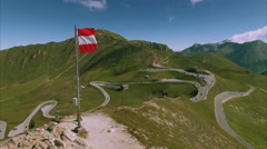 Austrian flag on the top of Grossglockner mountain pass Stock Footage