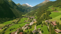 Picturesque village of Heiligenblut in the Alps from air Stock Footage