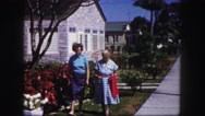 1960: two older women walking on beautiful street and talking about flowers Stock Footage