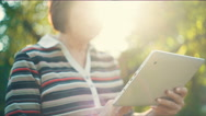Aged Woman With Tablet PC Stock Footage