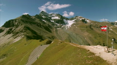 Austrian flag on the top of Grossglockner road Stock Footage