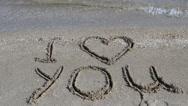Inscription on the beach.Shooting on the beach. Stock Footage