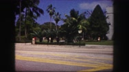 1960: people crossing the street in front of big building FLORIDA Stock Footage