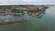 Aerial circling harbour of historical town at lake,Enkhuizen,Netherlands Stock Footage