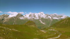 Traffic on the Grossglockner alpine road, aerial view Stock Footage