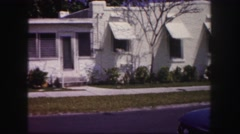 1960: city street lined with simple, small, nondescript houses FLORIDA Stock Footage