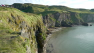 The side part of the mountain cliff in Carrick-a-Rede Stock Footage