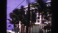 1960: driving past nice hotel with palm trees in the front FLORIDA Stock Footage