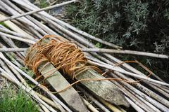 A bundle of twigs and garden twine on a garden path Stock Photos