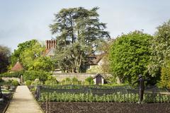 View across a walled garden an organic vegetable plot Stock Photos